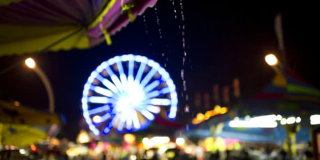 Rain poured down on the midway Saturday night at the CNE. (Photo by Lucas Oleniuk/Toronto Star via Getty Images)