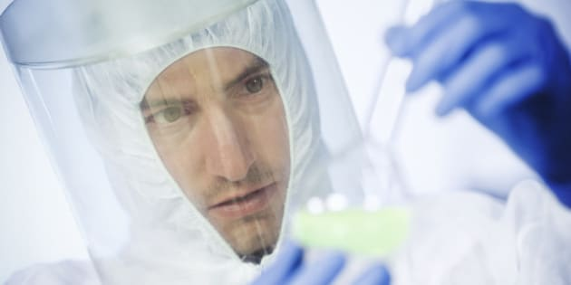 scientists working at the laboratory examining hazardous chemicals. close up
