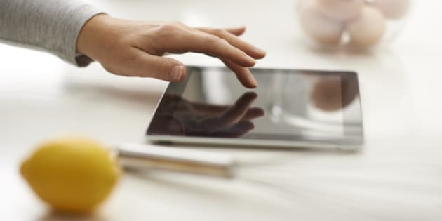 Female using digital tablet in the kitchen