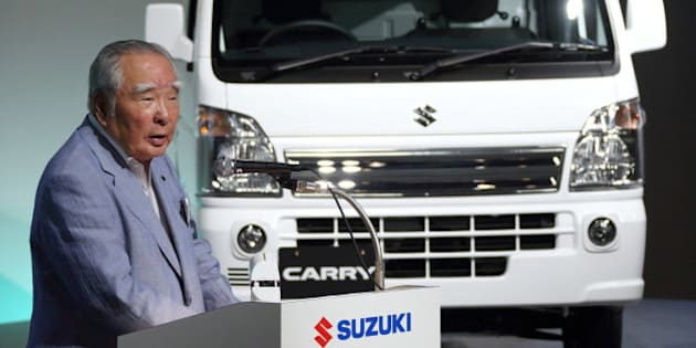 Osamu Suzuki, chairman, president and chief executive officer of Suzuki Motor Corp., speaks at the unveiling of the company's Carry mini-truck in Tokyo, Japan, on Thursday, Aug. 29, 2013. Nissan Motor Co. will sign original equipment manufacturer, or OEM, agreement on mini commercial vehicles and a wagon-type minicar with Suzuki, according to a statement on Nissa website. Photographer: Tomohiro Ohsumi/Bloomberg via Getty Images