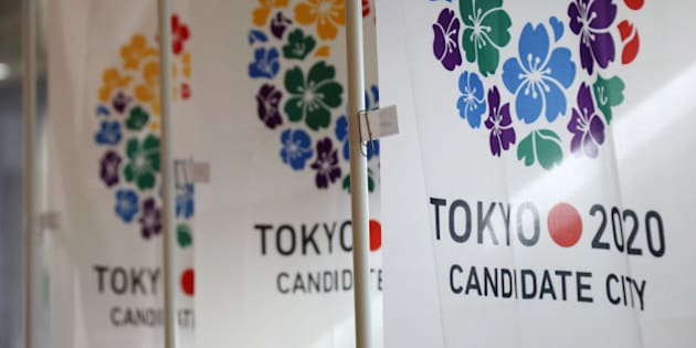 Flags promoting Japan's bid for the 2020 Olympics and Paralympic Games are displayed during a media tour in Tokyo, Japan, on Monday, July 29, 2013. Tokyo, the front-runner city to host the 2020 Olympics, is planning its biggest housing complex in 42 years to lodge athletes, a move that could benefit developers such as Shimizu Corp. and Mitsubishi Estate Co. Photographer: Tomohiro Ohsumi/Bloomberg via Getty Images