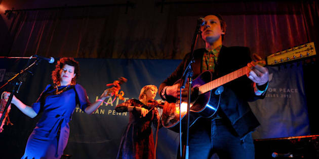 LOS ANGELES, CA - JANUARY 14:  (L-R) Musicians Regine Chassagne, Marika Anthony-Shaw and Win Butler of Arcade Fire perform onstage at the Cinema For Peace event benefitting J/P Haitian Relief Organization in Los Angeles held at Montage Hotel on January 14, 2012 in Los Angeles, California.  (Photo by Michael Buckner/Getty Images For J/P Haitian Relief Organization and Cinema For Peace)
