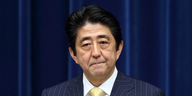 Shinzo Abe, Japan's prime minister, listens during a news conference at the prime minister's official residence in Tokyo, Japan, on Wednesday, June 26, 2013. Abe wants to focus on the economy for the next three years, he said today at a news conference in Tokyo marking the end of a parliamentary session. Photographer: Tomohiro Ohsumi/Bloomberg via Getty Images