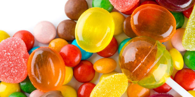 colorful candies on white...