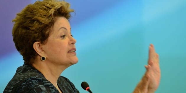 Brazilian President Dilma Rousseff delivers a speech during the announcement of the authorization to build private ports, at Planalto Palace in Brasilia, on July 3, 2013. AFP PHOTO/Evaristo SA        (Photo credit should read EVARISTO SA/AFP/Getty Images)