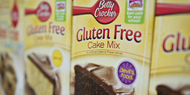 'Gluten Free' appears on the packaging for General Mills Inc. Betty Crocker brand cake mix displayed for sale at a supermarket in Princeton, Illinois, U.S., on Wednesday, Aug. 7, 2013. The Food and Drug Administration (FDA) is issuing a final rule to define the term 'gluten-free' when voluntarily used in food labeling, according to a notice published in the Aug. 5 Federal Register. Photographer: Daniel Acker/Bloomberg via Getty Images