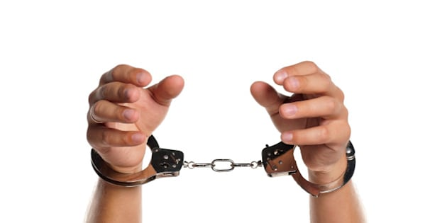 man hands with handcuffs...