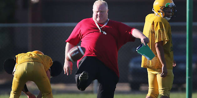 TORONTO, ON - SEPTEMBER 12: Toronto Mayor Rob Ford punts as he runs football practice at Don Bosco Secondary School after leaving City Hall before 2 pm in Toronto.        (Steve Russell/Toronto Star via Getty Images)