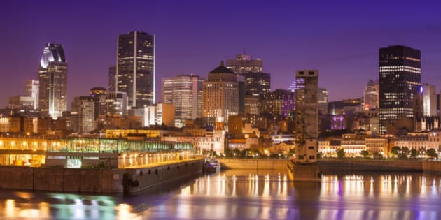 Downtown city skyline at night, showing St. Lawrence River, Montreal, Quebec, Canada