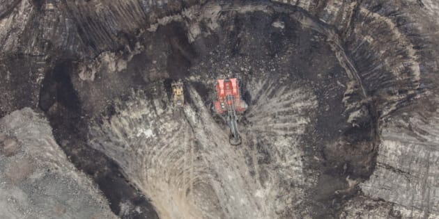 A large power shovel excavates bitumin loaded sand from the Alberta Oilsands near Fort McMurray.