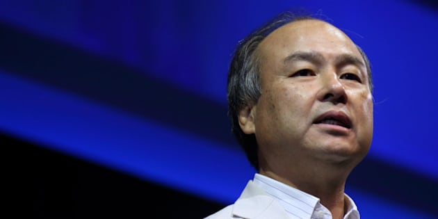 Masayoshi Son, chairman and chief executive officer of SoftBank Corp., speaks at the SoftBankWorld 2013 event in Tokyo, Japan, on Tuesday, July 23, 2013. SoftBank, which had its credit rating cut to junk on July 18 after completing its $21.6 billion acquisition of a controlling stake in Sprint Corp., is pursuing deals outside its home market to tap faster growth. Photographer: Tomohiro Ohsumi/Bloomberg via Getty Images