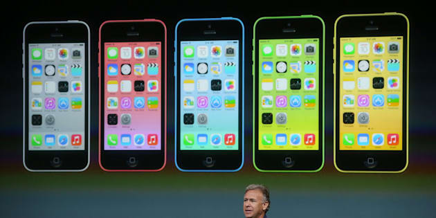 CUPERTINO, CA - SEPTEMBER 10:  Apple Senior Vice President of Worldwide Marketing Phil Schiller speaks about the new iPhone 5C during an Apple product announcement at the Apple campus on September 10, 2013 in Cupertino, California. The company launched the new iPhone 5C model that will run iOS 7 is made from hard-coated polycarbonate and comes in various colors. (Photo by Justin Sullivan/Getty Images)