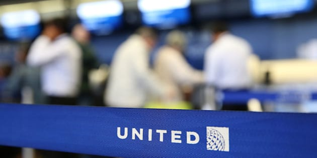 SAN FRANCISCO, CA - JULY 25:  The United Airlines name is displayed on a barrier at San Francisco International Airport on July 25, 2013 in San Francisco, California.  United Continental Holdings, the parent company of United Airlines, reported record revenues with second quarter earnings of $469 million.  (Photo by Justin Sullivan/Getty Images)