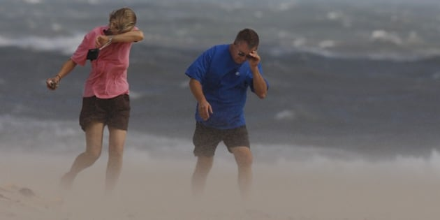 Karen and Mark Primeau, of Unionville, Virginia, brave wind-blown sand from Tropical Storm Gabrielle at the former site of the Cape Hatteras lighthouse near Buxton, North Carolina on the Outer Banks Sunday, September 9, 2007. The weak tropical storm landed at the Outer Banks with 50mph winds.  (Photo by Chuck Liddy/Raleigh News & Observer/MCT via Getty Images)