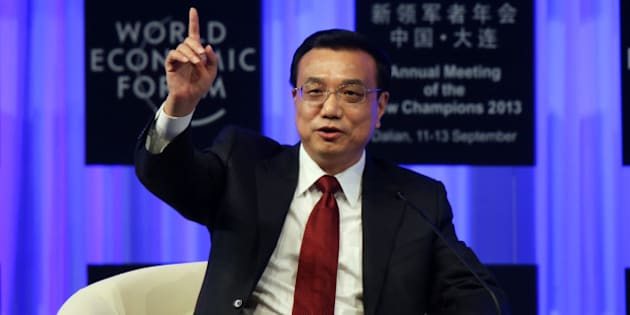 Li Keqiang, China's premier, gestures as he speaks during the opening plenary at the World Economic Forum Annual Meeting of The New Champions in Dalian, China, on Wednesday, Sept. 11, 2013. Li said the foundations of a growth rebound aren't solid while cautioning that stimulus won't help resolve deep-rooted issues in the world's second-largest economy. Photographer: Tomohiro Ohsumi/Bloomberg via Getty Imagesg