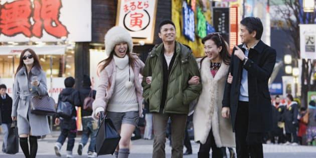 Asian friends crossing street