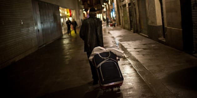 BARCELONA, SPAIN - JANUARY 11:  A homeless walks the street after dining at the 'El Chiringuito de Dios' ('the Stall of God') on January 11, 2013 in Barcelona, Spain. The German pastor Wolfgang Striebinger has lived in Barcelona since 1991, originally employed to minister to youths during the Barcelona Olympic Games, he decided to stay and since 2000 has run 'El Chinguito de Dios' (The Stall of God). In his mission to support the homeless, Wolfgang and his volunteers offer a place for up to 200 people to come and have some food daily and also offering them assistance with grooming and clothes. Many of the volunteers are homeless and help out in return for meals and a bed. Wolfgang's ethos is to provide peace, calm and dignity to all those that need it amongst Barcelona's burgeoning homeless population. Due to the economic situation his doors are now also open to the long term unemployed and families with little or no income. According to the latest figures 21.8% of the Spanish populations are living below the poverty line. (Photo by David Ramos/Getty Images)