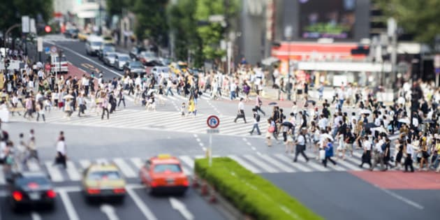 Famous six way pedestrian crossing photographed with tilt lens in Shibuya, Tokyo, Japan