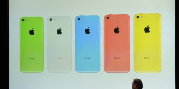 Philip Schiller, senior vice president of worldwide marketing at Apple Inc., introduces a new iPhone 5C during a product announcement in Cupertino, California, U.S., on Tuesday, Sept. 10, 2013. Apple Inc. announced two new iPhones including one with lower prices and more color options, in a strategy shift by Chief Executive Officer Tim Cook to reach a broader range of customers around the world. Photographer: David Paul Morris/Bloomberg via Getty Images