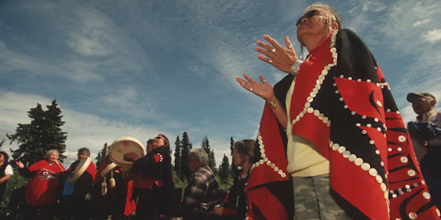 Lili Moyer, a Tahltan leader, prays at a ceremony celebrating the Sacred Headwaters, birthplace of three of Canada's most important salmon rivers, the Stikine, the Skeena, and Nass, British Colombia, Canada, 2006. (Photo by Wade Davis/Getty Images)