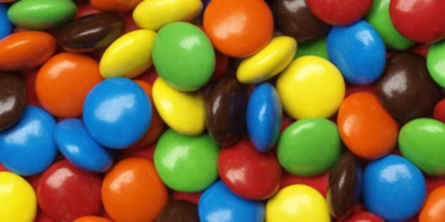 Full of multicolored chocolate candies.