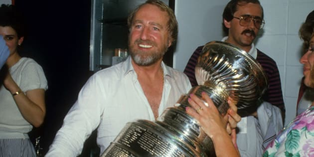 EDMONTON, AB - MAY 30:  Owner Peter Pocklington of the Edmonton Oilers celebrates with the Stanley Cup Trophy in the locker room after the Oilers defeated the Philadelphia Flyers in Game 5 of the 1985 Stanley Cup Finals on May 30, 1985 at the Northlands Coliseum in Edmonton, Alberta, Canada.  (Photo by B Bennett/Getty Images)