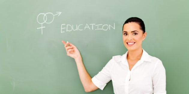 female teacher pointing at sex...
