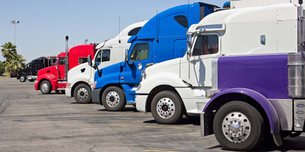 multiple trucks park in a large ...