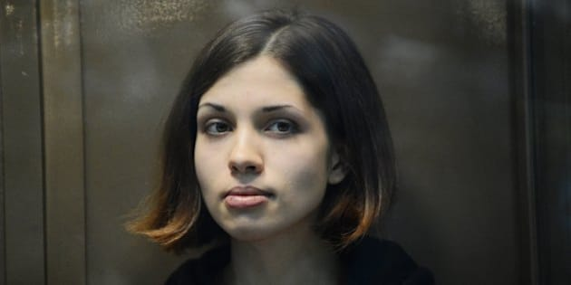 One of the jailed members of the all-girl punk band 'Pussy Riot,' Nadezhda Tolokonnikova, looks on while sitting in a glass-walled cage in a court in Moscow, on October 10, 2012. A Moscow court heard today the appeal of feminist punks Pussy Riot against their two-year prison camp sentence, days after President Vladimir Putin appeared to give his blessing to the verdict. AFP PHOTO / NATALIA KOLESNIKOVA        (Photo credit should read NATALIA KOLESNIKOVA/AFP/GettyImages)