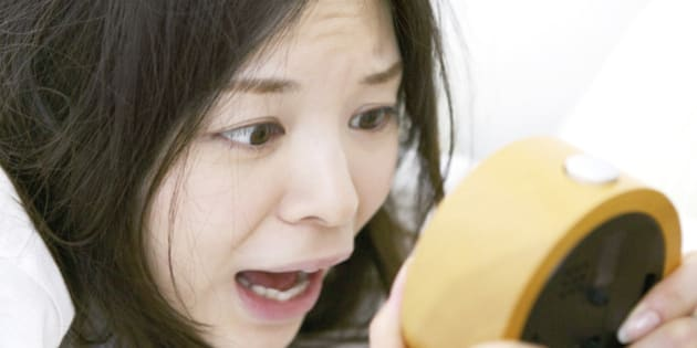 Japanese woman overslept shocking with looking at clock