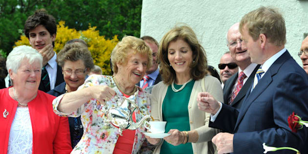 NEW ROSS, IRELAND - JUNE 22: Anna Rowe, Caroline Kennedy and Enda Kenny recreate the tea party of John F. Kennedy's visit to his ancestral homestead as part of commemorations for the 50th anniversary of the visit by US President John F Kennedy, on June 22, 2013 in New Ross, Ireland. The Eternal Flame from Kennedy's grave was used to light a flame on the quayside where he gave a speech in 1963. (Photo by Clodagh Kilcoyne/Getty Images)