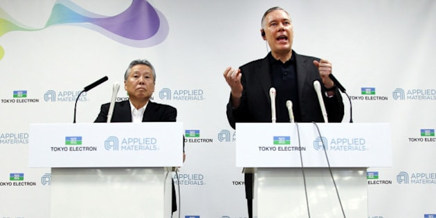 Gary Dickerson, chief executive officer of Applied Materials Inc., right, speaks as Tetsuro 'Terry' Higashi, chairman of Tokyo Electron Ltd., listens during a news conference in Tokyo, Japan, on Tuesday, Sept. 24, 2013. Applied Materials, the largest supplier of chipmaking equipment, agreed to pay $9.39 billion in stock for rival Tokyo Electron and plans to cut costs amid a slump in demand for semiconductors. Photographer: Junko Kimura/Bloomberg via Getty Images