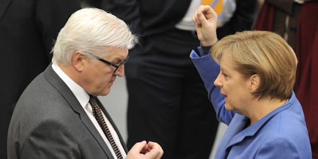 German Chancellor Angela Merkel speaks to Frank-Walter Steinmeier, leader of the Social Democratic Party's (SPD) parliamentary group, before addressing the Bundestag lower house of parliament in Berlin March 25, 2010, ahead of a crunch EU summit in Brussels. Merkel stuck to her hardline position on Greece ahead of  the EU summit starting 26 March, saying she refused to violate 'the trust' of the German people in the euro. AFP PHOTO / JOHN MACDOUGALL (Photo credit should read JOHN MACDOUGALL/AFP/Getty Images)