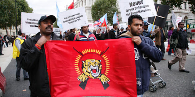 LONDON - OCTOBER 17: Demonstrators display a banner during a march by Tamils from the Embankment to Hyde Park on October 17, 2009 in London, England. The protest sought to highlight conditions in camps used to detain of civilians following the defeat earlier this year of the Tamil Tigers separatist movement by Sri Lankan government forces. (Photo by Rudy Cech/Barcroft Media/Getty Images)