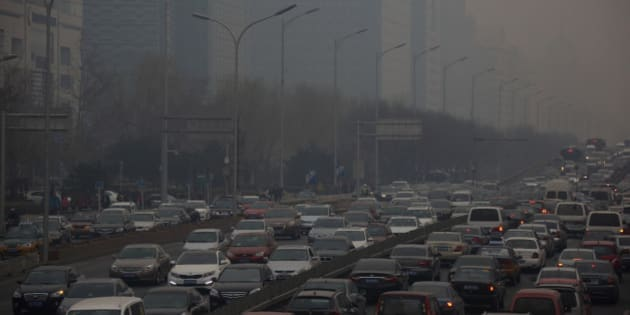Traffic moves along a street shrouded in haze in Beijing, China, on Friday, March 15, 2013. China's new premier promised to crack down on corruption and clean up pollution, acknowledging the need to tackle two issues that have stoked public anger toward the country's leaders. Photographer: Tomohiro Ohsumi/Bloomberg via Getty Images