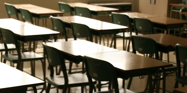 A view of a class room(chairs and tables) at a junior high school