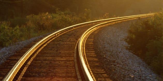 Evening light shining on railway track