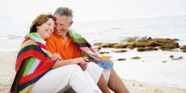 happy mature couple sitting on...