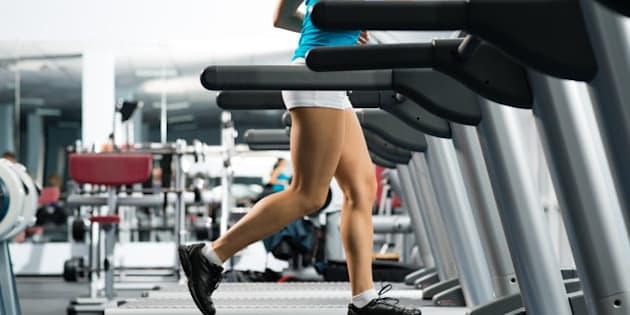 woman running on a treadmill in ...