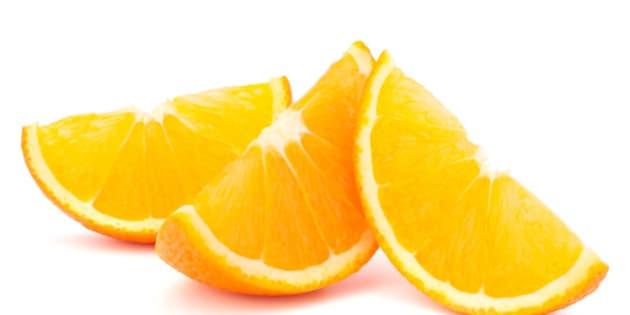 three orange fruit segments or...