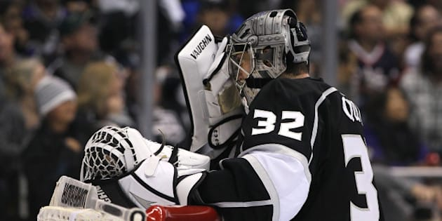 LOS ANGELES, CA - OCTOBER 07:  Goaltender Jonathan Quick #32 of the Los Angeles Kings reacts after misplaying the puck and allowing a goal in the third period of their NHL game against the New York Rangers at Staples Center on October 7, 2013 in Los Angeles, California. The Rangers defeated the Kings 3-1.  (Photo by Victor Decolongon/Getty Images)