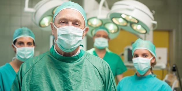 smiling surgeon posing with a...