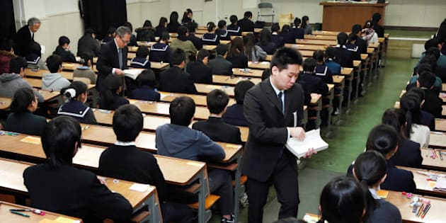 FUKUOKA, JAPAN - FEBRUARY 25:  (CHINA OUT, SOUTH KOREA OUT) University staffs distrubute the papers at Kyushu University on February 25, 2013 in Fukuoka, Japan. 260,000 applicants take the examination.  (Photo by The Asahi Shimbun via Getty Images)
