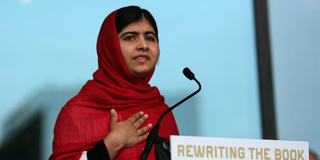 BIRMINGHAM, ENGLAND - SEPTEMBER 03:  Malala Yousafzai opens the new Library of Birmingham at Centenary Square on September 3, 2013 in Birmingham, England. The new futuristic building was officially opened by 16-year-old Malala Yousafzai who was attacked by Taliban gunmen on her school bus near her former home in Pakistan in October 2012. The new building  was designed by architect Francine Hoube and has cost 189 million GBP. The modern exterior of interlacing rings reflects the canals and tunnels of Birmingham. The library's ten floors will house the city's internationally important collections of archives, photography and rare books as well as it's lending library.  (Photo by Christopher Furlong/Getty Images)