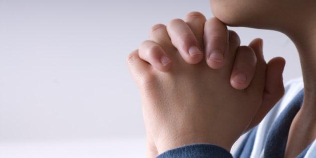 small boy praying before going...