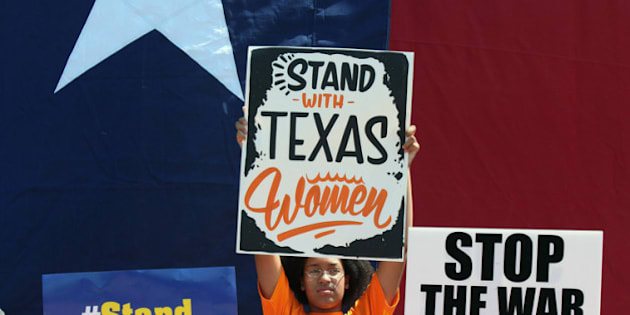 AUSTIN, TX - JULY 01: Supporters of Texas women's right to reproductive decisions rally at the Texas State capitol on July 1, 2013 in Austin, Texas. This is first day of a second legislative special session called by Texas Gov. Rick Perry to pass an restrictive abortion law through the Texas legislature. The first attempt was defeated after opponents of the law were able to stall the vote until after first special session had ended.  (Photo by Erich Schlegel/Getty Images)