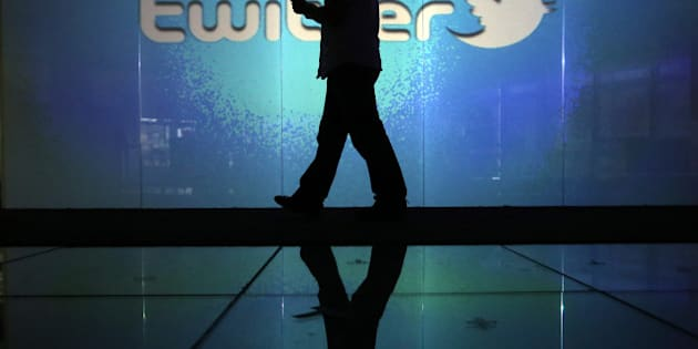 A user checks a Twitter feed on a smartphone in this arranged photograph taken in London, U.K., on Friday, Oct. 4, 2013. Twitter Inc.'s initial public offering documents suggested a valuation of $12.8 billion for the microblogging service, underscoring the seven-year rise of a still unprofitable company that has helped revolutionize how people share information. Photographer: Chris Ratcliffe/Bloomberg via Getty Images