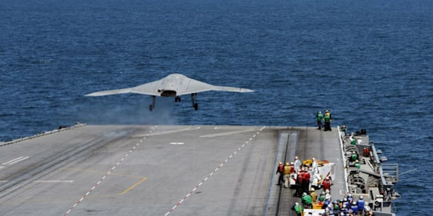 ATLANTIC OCEAN - MAY 14:  In this handout released by the U.S. Navy, An X-47B Unmanned Combat Air System (UCAS) demonstrator launches from the flight deck of the aircraft carrier USS George H.W. Bush (CVN 77) May 14, 2013 in the Atlantic Ocean. George H.W. Bush is the first aircraft carrier to sucessfully catapult-launch an unmanned aircraft from its flight deck. The Navy plans to have unmanned aircraft on each of its carriers to be used for surveillance and be armed and used in combat roles.  (Photo by U.S. Navy via Getty Images)