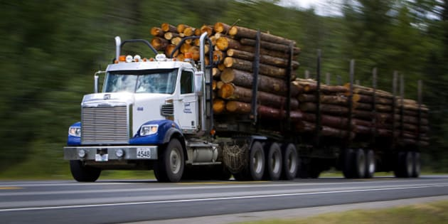 A logging truck transports a load of newly cut logs down Highway 97 in Quesnel, British Columbia, Canada, on Thursday, July 11, 2013. West Fraser Timber Co., the largest lumber producer in North America, had a sustainable rise in price, demand volatility, and profits within the past year. Photographer: Ben Nelms/Bloomberg via Getty Images