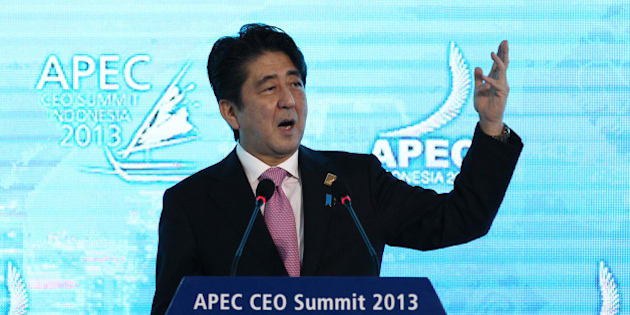 Shinzo Abe, Japan's prime minister, gestures as he delivers a keynote speech at the Asia-Pacific Economic Cooperation (APEC) CEO Summit in Nusa Dua, Bali, Indonesia, on Monday, Oct. 7, 2013. Japan must make certain deflation is 'swept away,' Abe said. Photographer: SeongJoon Cho/Bloomberg via Getty Images